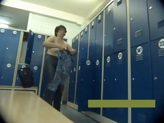 middle-aged mother disrobes in locker room